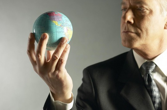 Business-Man-Holding-Globe-Business